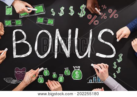 Hands Drawing Bonus And Employee Compensation Concept