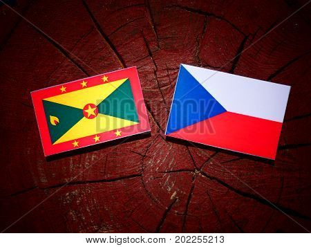 Grenada Flag With Czech Flag On A Tree Stump Isolated