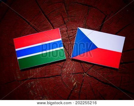 Gambia Flag With Czech Flag On A Tree Stump Isolated