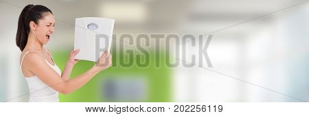 Digital composite of Slim healthy woman holding weighing scales