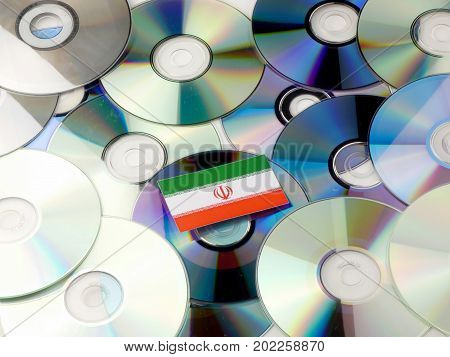 Iranian Flag On Top Of Cd And Dvd Pile Isolated On White
