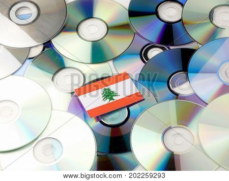 Lebanese Flag On Top Of Cd And Dvd Pile Isolated On White
