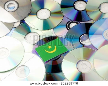 Mauritania Flag On Top Of Cd And Dvd Pile Isolated On White