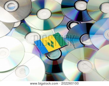 Saint Vincent And The Grenadines Flag On Top Of Cd And Dvd Pile Isolated On White