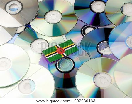 Dominica Flag On Top Of Cd And Dvd Pile Isolated On White