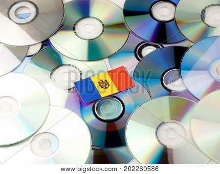 Moldovan Flag On Top Of Cd And Dvd Pile Isolated On White