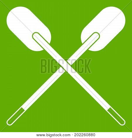 Two wooden crossed oars icon white isolated on green background. Vector illustration