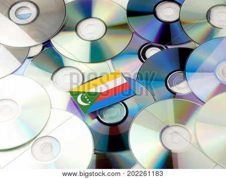Comoros Flag On Top Of Cd And Dvd Pile Isolated On White