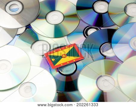 Grenada Flag On Top Of Cd And Dvd Pile Isolated On White