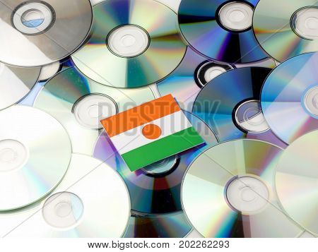 Niger Flag On Top Of Cd And Dvd Pile Isolated On White