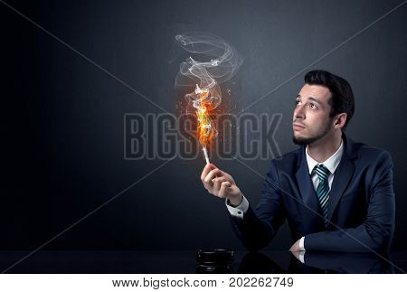 Businessman smoking with inferno effect.