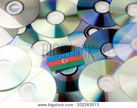 Azerbaijan Flag On Top Of Cd And Dvd Pile Isolated On White