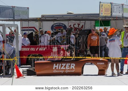 Bonneville Salt Flats Utah USA - August 12 2016: Race organizers and mechanics at the Bonneville Salt Flats inspect race cars in the scorching summer heat ahead of the Southern California Timing Association's Speed Week races.