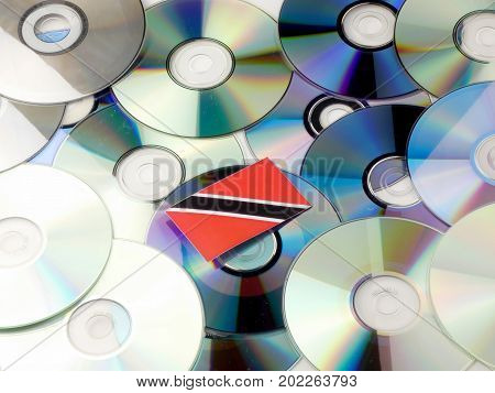 Trinidad And Tobago Flag On Top Of Cd And Dvd Pile Isolated On White