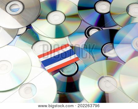 Thai Flag On Top Of Cd And Dvd Pile Isolated On White