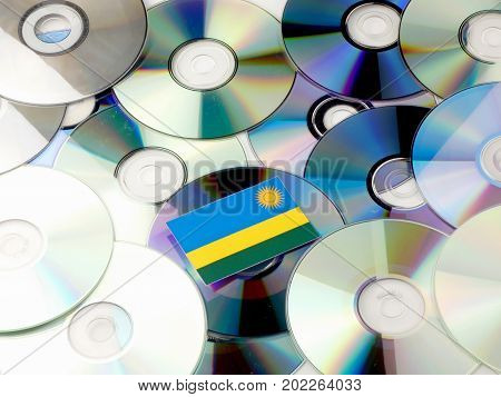 Rwanda Flag On Top Of Cd And Dvd Pile Isolated On White