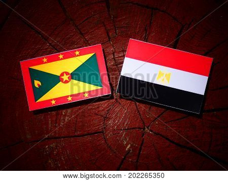 Grenada Flag With Egyptian Flag On A Tree Stump Isolated