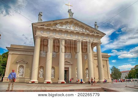 VILNIUS, LITHUANIA - JULY 19, 2015: Tourists walking near Cathedral on Cathedral Square in Vilnius, Lithuania. The Cathedral of Vilnius is the main Roman Catholic Cathedral of Lithuania.