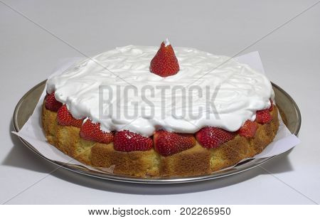 Strawberry Sponge Cake With Whipped Cream On A Salver