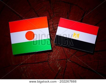 Niger Flag With Egyptian Flag On A Tree Stump Isolated