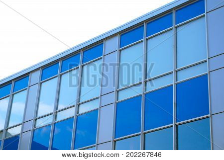 skyscraper building office building blue glass windows angle commercial modern finance