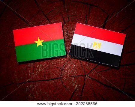 Burkina Faso Flag With Egyptian Flag On A Tree Stump Isolated