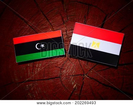 Libyan Flag With Egyptian Flag On A Tree Stump Isolated