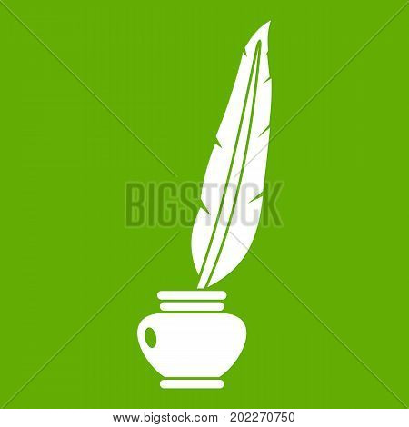 Feather quill pen standing in the bottle of ink icon white isolated on green background. Vector illustration