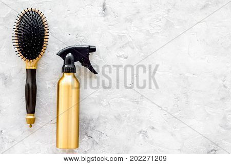 beauty salon golden work tools with comb for hair dress and coloring on stone desk background top view mock up