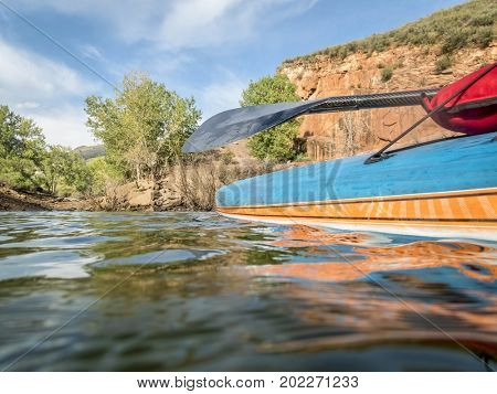 Stand up paddleboard with a carbon fiber paddle - low angle view on Horsetooth Reservoir in northern Colorado