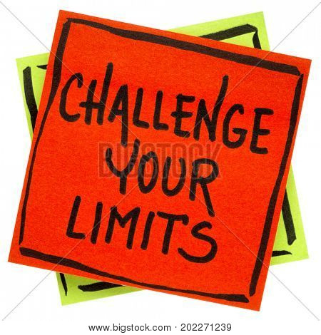 challenge your limits inspirational  reminder note - handwriting in black ink on an isolated sticky note