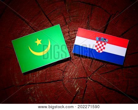 Mauritania Flag With Croatian Flag On A Tree Stump Isolated