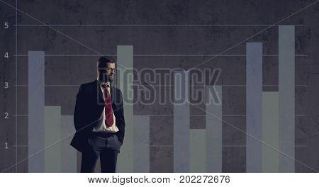 Businessman standing over column diagram background. Business, office, career, job concept.