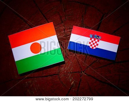 Niger Flag With Croatian Flag On A Tree Stump Isolated