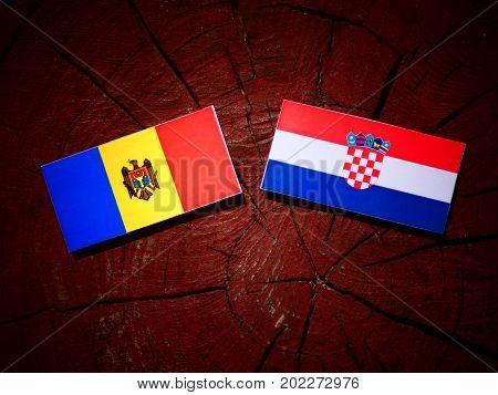 Moldovan Flag With Croatian Flag On A Tree Stump Isolated