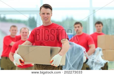 foreman and workers with boxes of building materials
