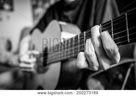 Musician Playing Acoustic Guitar, Black And White Photo