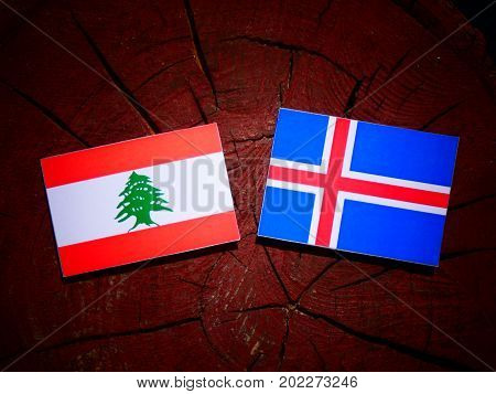 Lebanese Flag With Icelandic Flag On A Tree Stump Isolated