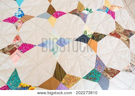 garment industry, applique, creativity. perfectly lined up and symmetrical applications on old blanket have abstract images of threes, plants and other russian traditional signs