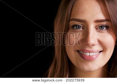 Close Up Head And Shoulders Studio Portrait Of Smiling Woman