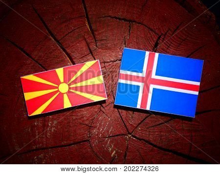 Macedonian Flag With Icelandic Flag On A Tree Stump Isolated
