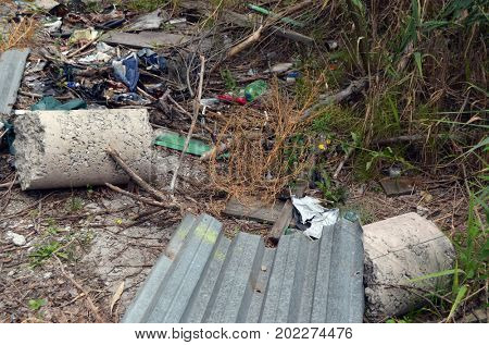 Nature near Ukrainian capital.Environmental contamination. Illegal junk dump. August 31, 2017.Near Kiev, Ukraine