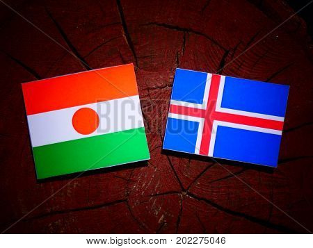 Niger Flag With Icelandic Flag On A Tree Stump Isolated