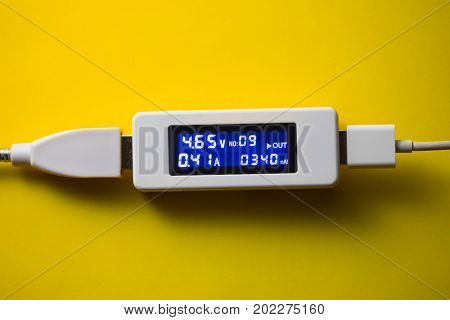 battery tester diagnostic tool, yellow background