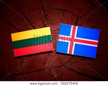 Lithuanian Flag With Icelandic Flag On A Tree Stump Isolated
