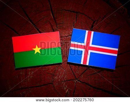 Burkina Faso Flag With Icelandic Flag On A Tree Stump Isolated