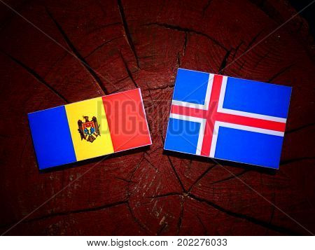 Moldovan Flag With Icelandic Flag On A Tree Stump Isolated