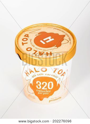DALLAS TEXAS - AUGUST 29 2017: A pint of Halo Top a high-protein low-sugar and low-calorie Ice Cream in sea salt caramel flavor. The diet-friendly Halo Top Creamery ice cream was launched in 2012.