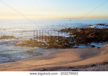 Empty beach at sunset, peaceful scenery travel lust