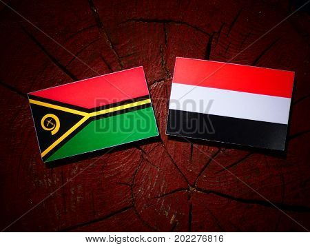 Vanuatu Flag With Yemeni Flag On A Tree Stump Isolated